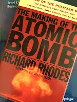 The Making of the Atomic Bomb, by Richard Rhodes, superimposed on Intermediate Physics for Medicine and Biology.