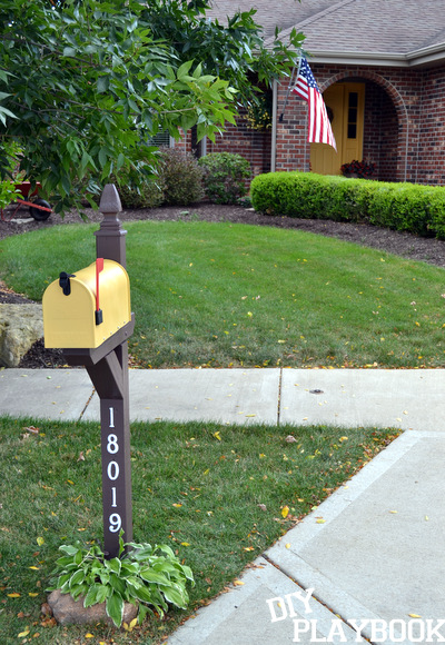Yellow mailbox in front of house