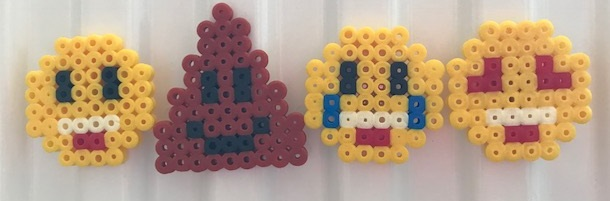 Hama bead emoji magnets on the radiator