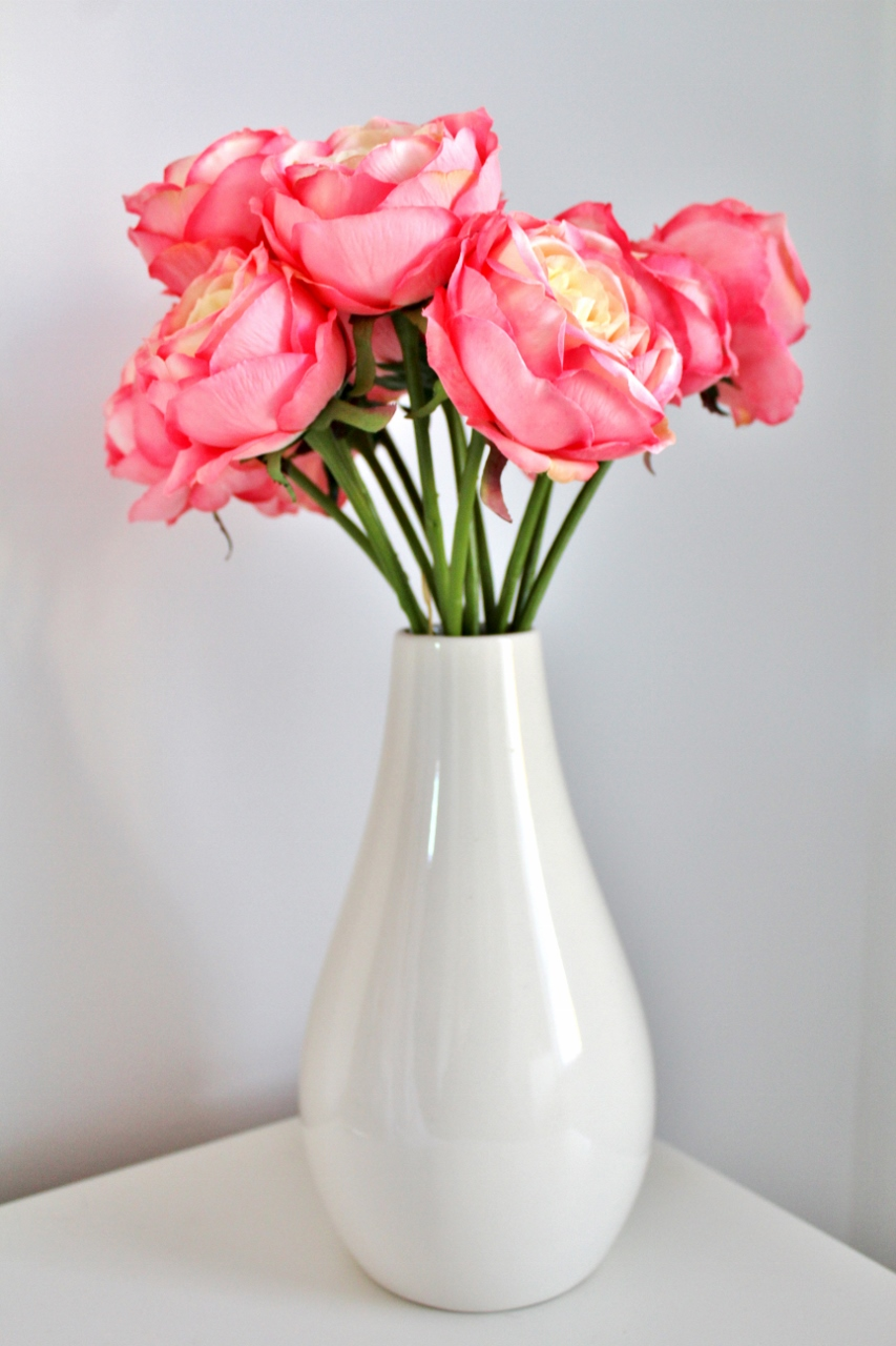 Fake pink peonies in white vase