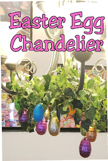 Take your Easter Egg hunt inside with this fun Easter decoration. It's so easy to decorate your dinning room chandelier with beautiful Easter eggs and greenery to make a stunning Easter Egg Chandelier that will bring some extra sparkle and shine to your Easter dinner. #easter #easterdecoration #diy #chandelier #diypartymomblog