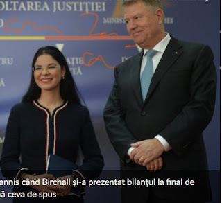 Ana Birchall smiling next to Iohannis
