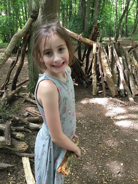 Sasha building dens in wood