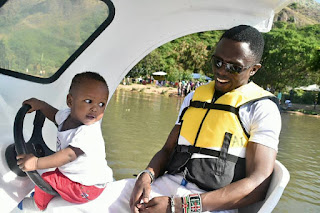 Ababu Namwamba with his child in Lake Victoria. PHOTO | Courtesy