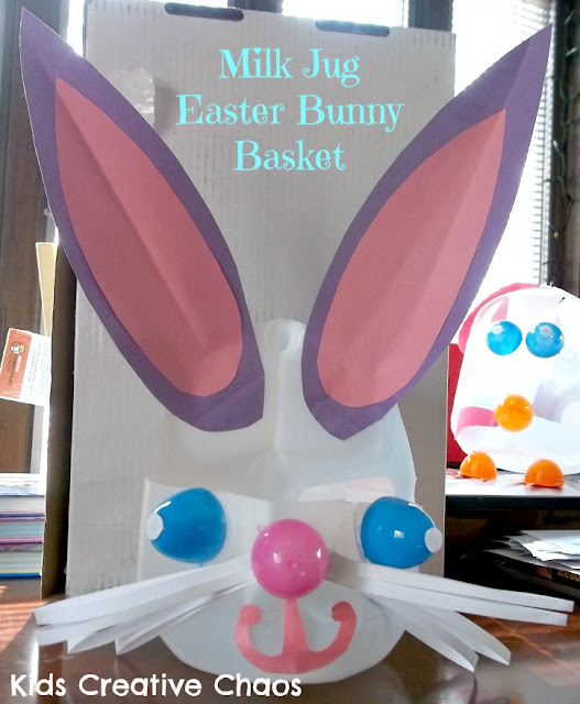 Easter Bunny Basket made from a milk jug with plastic Easter eggs and long paper ears and whiskers.
