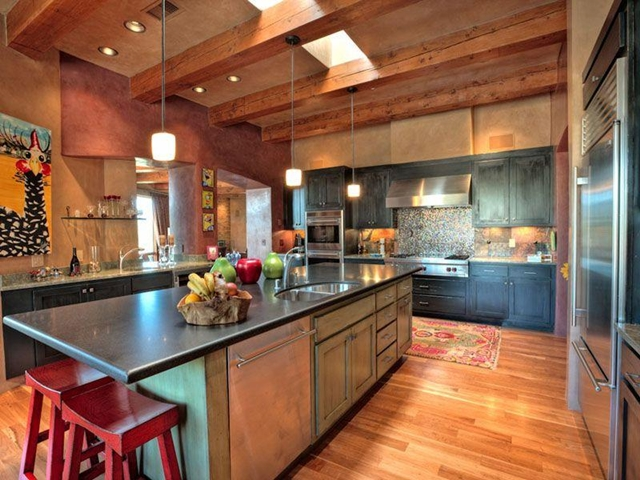 Photo of big kitchen with wooden furniture