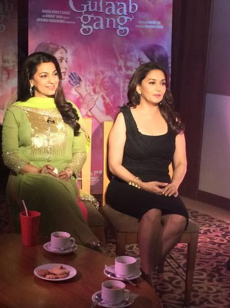 Juhi Chawala and Madhuri Dixit sitting on chairs