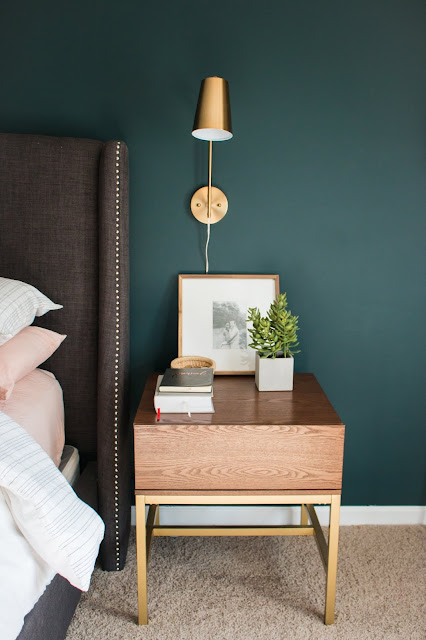 Sherwin Williams Cascades. Brass Sconces. Modern Nightstand. Upholstered Gray Headboard with Nailheads.