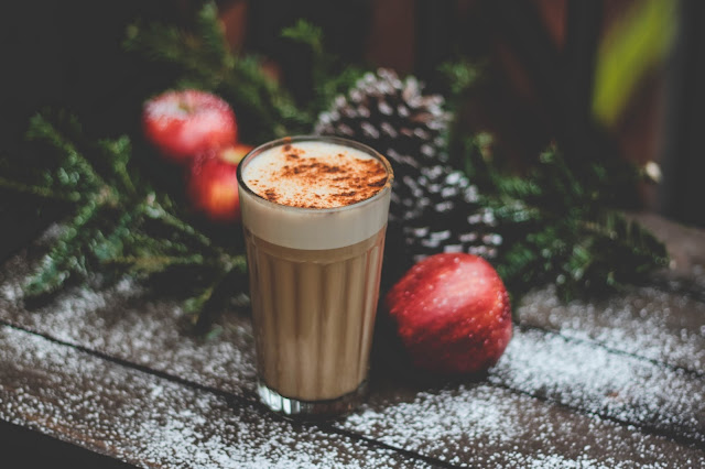 Christmas latte and greenery