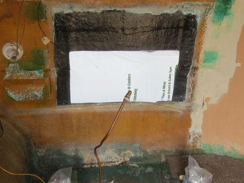 hole in fiberglass trailer wall