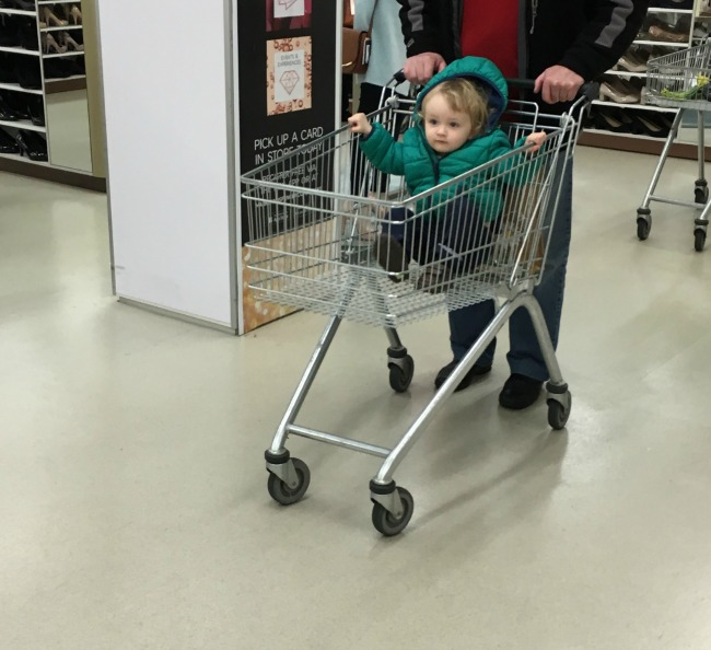 toddler sat in shopping trolley