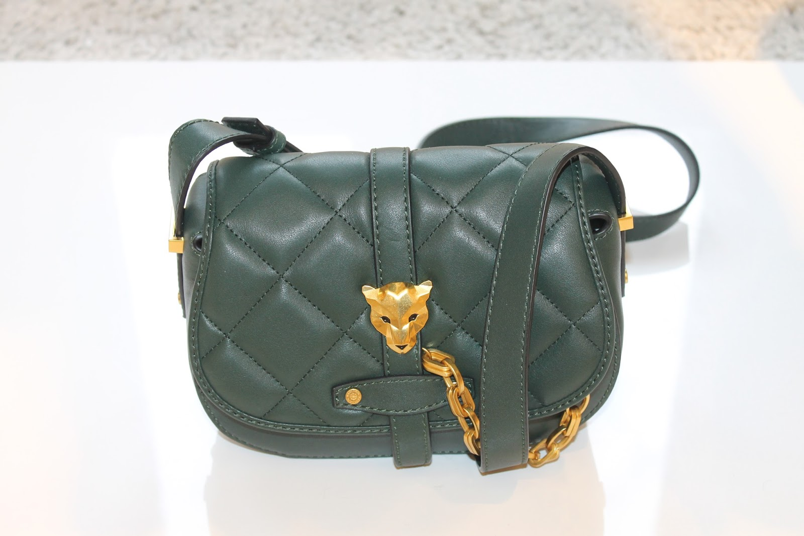 67755ea7f0 ... it gorgeous this quilted cross body bag by Marc Cain ? It is made of  calf leather, with gold hardware in this rich dark green colour. The shoulder  strap ...