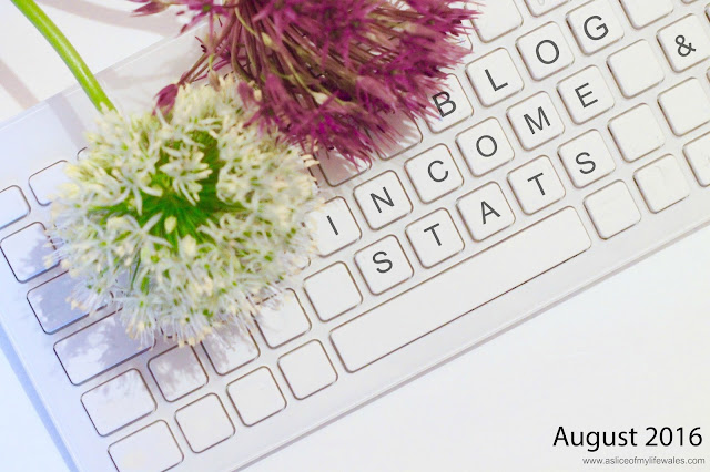 flowers on keyboard header image for blogging income and stats report August 2016 a slice of my life wales