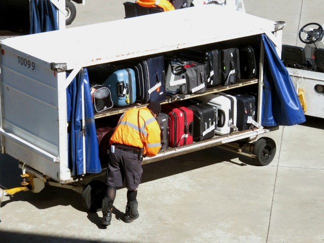 How-to-Ensure-You-Get-Your-Bag-Intact-in-the-Airport-Arrivals-Hall-luggage-in-cart-at-airport