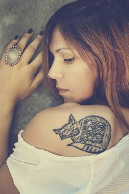 tato binatang di punggung