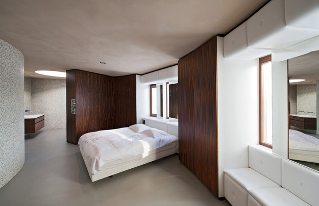 Photo of modern bedroom with wooden and white walls