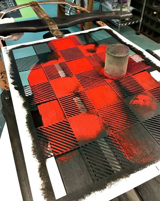 Stenciling red on a stencil on the sled