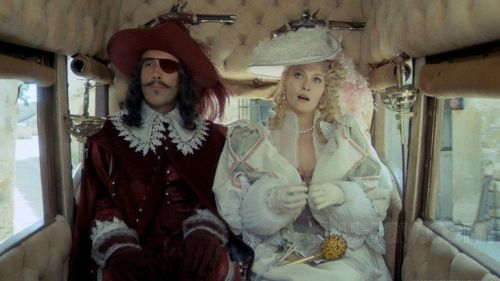 Christopher Lee and Faye Dunaway in a carriage in The Four Musketeers