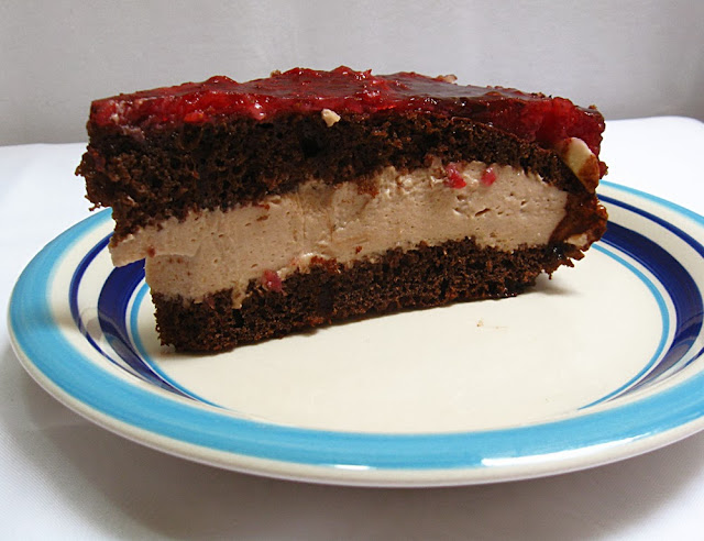 Homemade easy chocolate cake with raspberry jelly on top