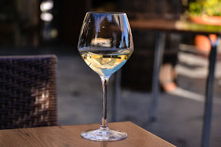 "© Marta Segadães | Dreamstime.com - <a href=""http://www.dreamstime.com/stock-photo-glass-white-wine-half-full-empty-image50580768#res8220357"">Glass of white wine half full</a>"