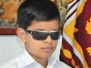 Handicapped student excels at Grade 5 Exam
