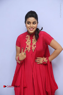 Actress Poorna Latest Stills in Red Dress at Rakshasi First Look Launch  0048.JPG