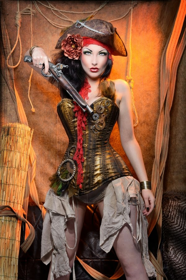 steampunk pirate womans costume with hat, corset and gun.