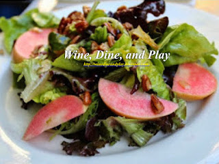 The mixed green salad at the Harvest Moon restaurant in Sonoma, California has pecans and pink pearl apples