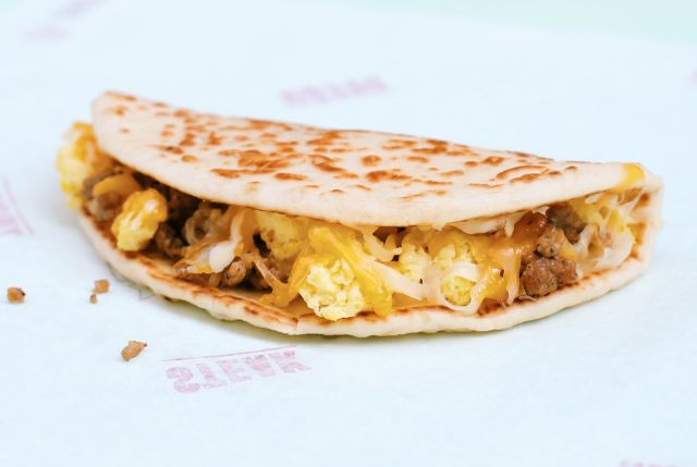 The Sausage Flatbread Quesadilla features a grilled flatbread filled ...