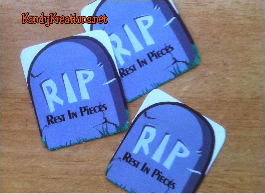 Celebrate with all your ghouls at your Halloween party using this Rest in Pieces candy box free printable.   You won't mind visiting your Halloween Tombstone when it's filled with Reeses Pieces candies and is so cheap and easy to make.
