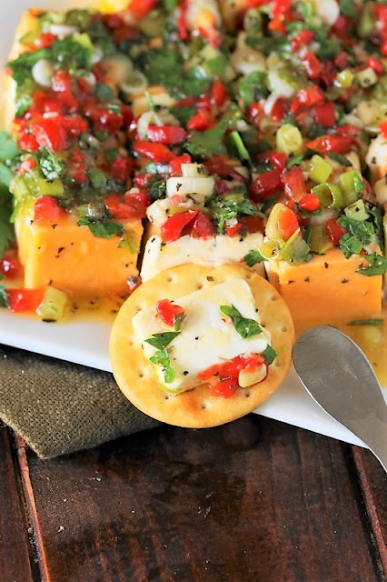 Marinated cheese - colorful, beautiful, and absolutely delicious.  It's the perfect party food for any occasion.