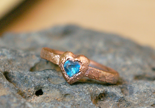 https://www.etsy.com/ca/listing/620347121/swiss-blue-topaz-heart-promise-ring