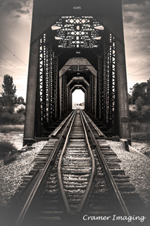 Cramer Imaging's professional fine art photograph of a railroad or train bridge over a river between Fremont and Madison counties, Idaho