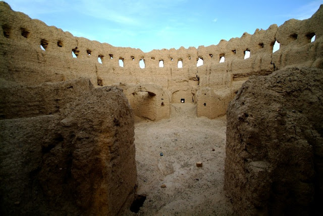 The walls of Ghoortan Castle in Varzaneh Desert.
