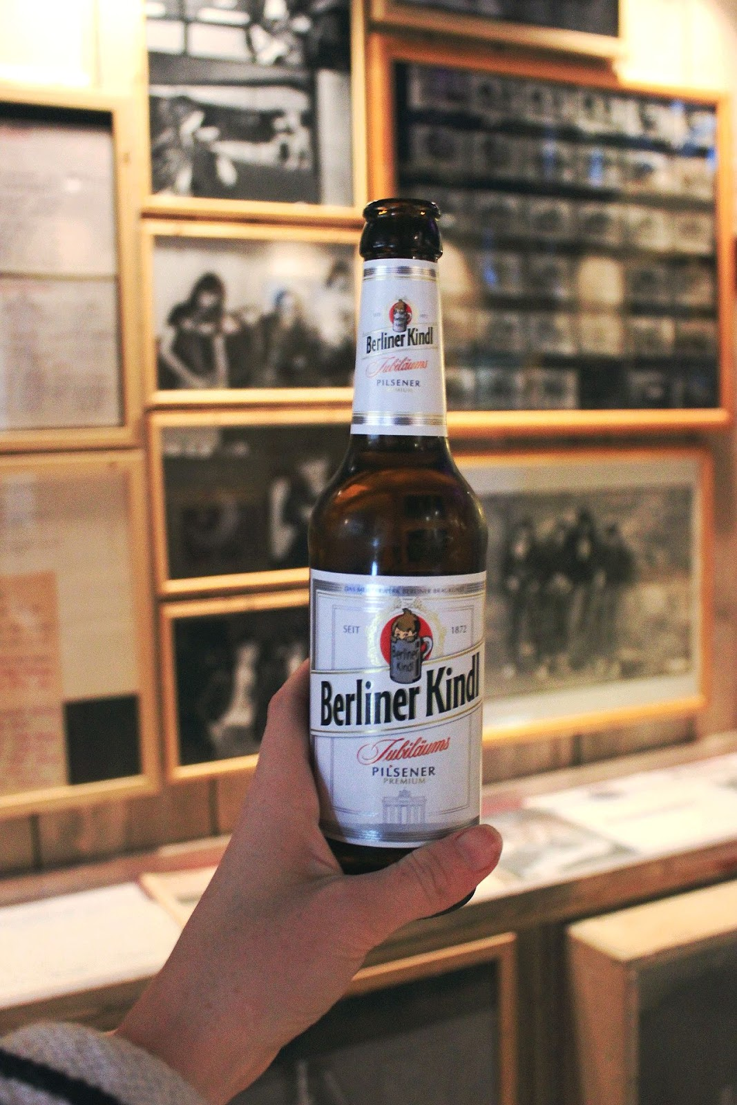Hand holding a beer that you get upon entry to the museum