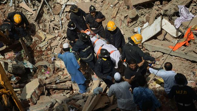 Building collapse in India kills 16; dozens trapped