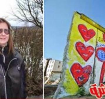 امرأة تتزوج من حائط برلين