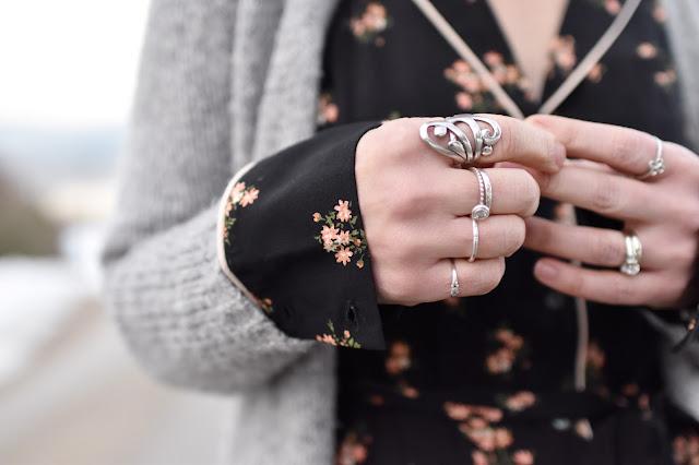 Monika Faulkner outfit inspiration - floral pyjama-style shirtdress, grey wool cardigan, stacked rings