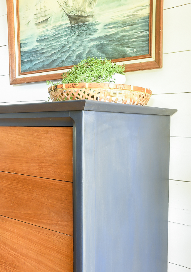 Dark wax detail on coastal blue MCM dresser makeover