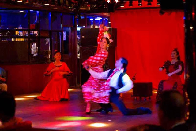 four Flamenco performers on stage