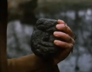 Harry finds a stone head in the pond in To Kill A King by Alan Garner