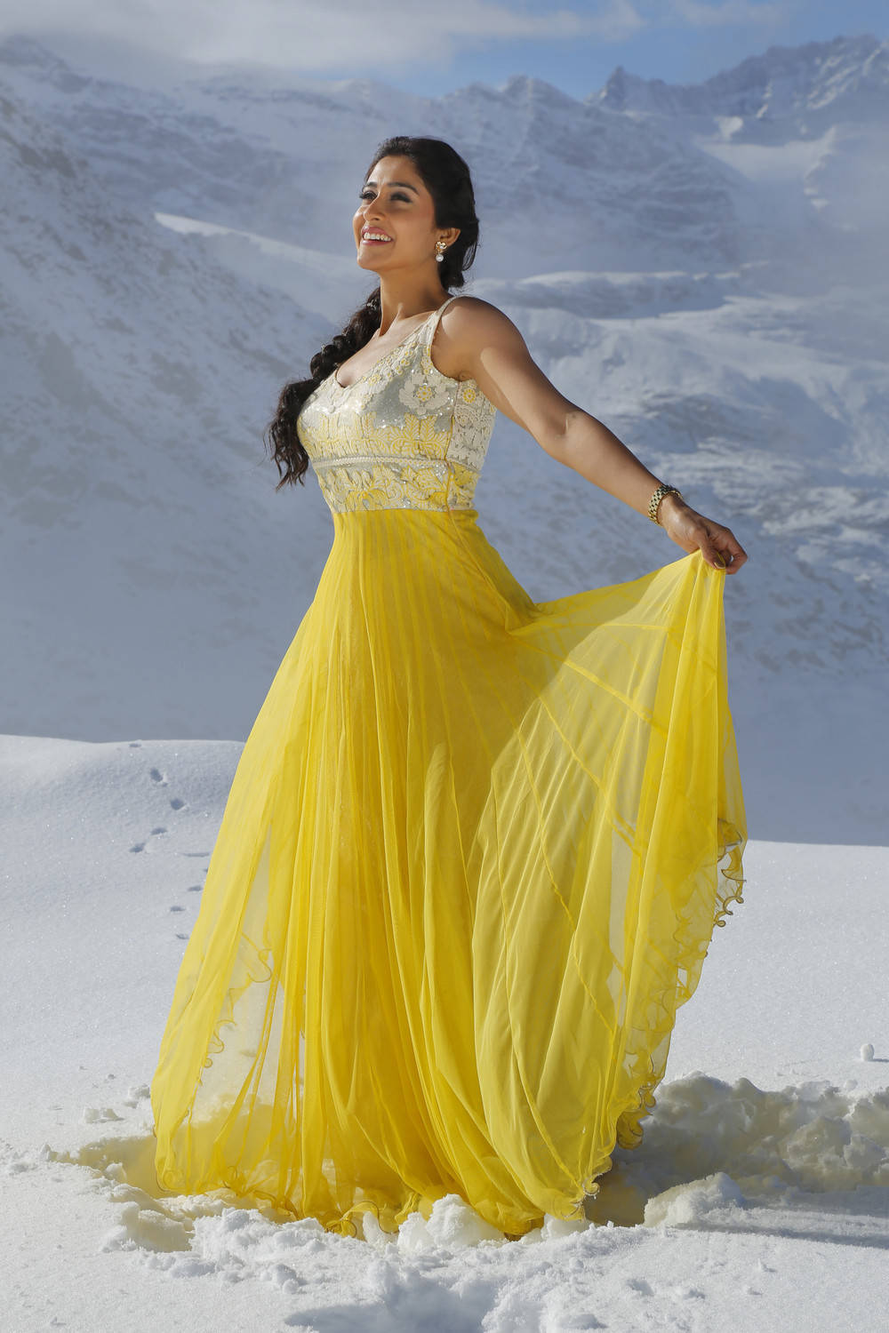 Regina Cassandra Stills From Soukyam Movie In Yellow Dress