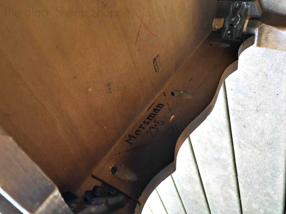 Mersman manufacturer's stamp underneath the end table.