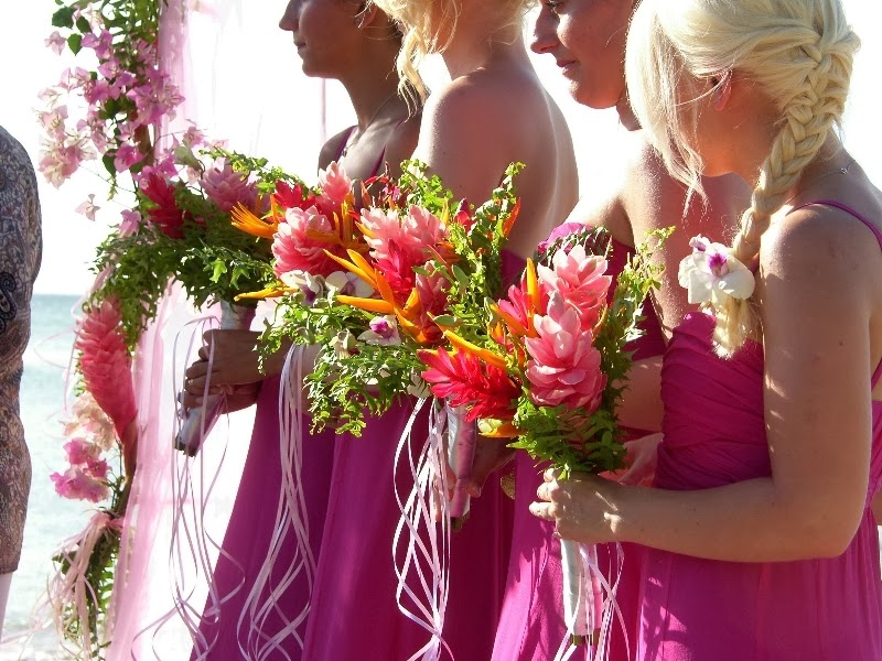 Tropical bridesmaids bouquets with gingers, orchid and heliconia