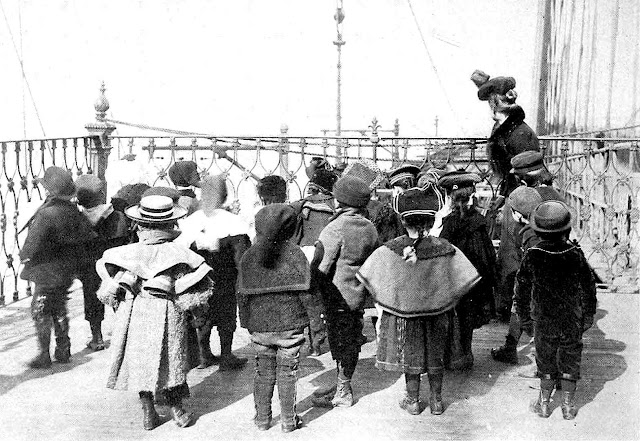 a photograph of 1909 children on a school trip with their teacher, detailed clothing
