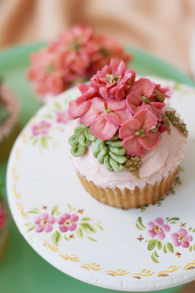 so thrilled to be making these buttercream flower cupcakes for bridal showers in kampala each cupcake is different decorated with small flowers and leaves