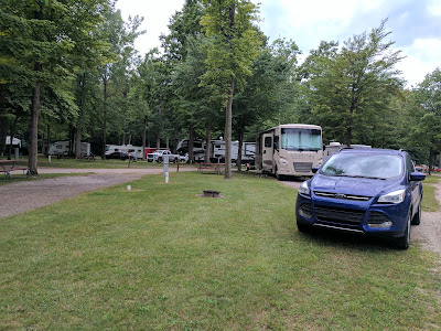 Our RV and Escape on our campsite.