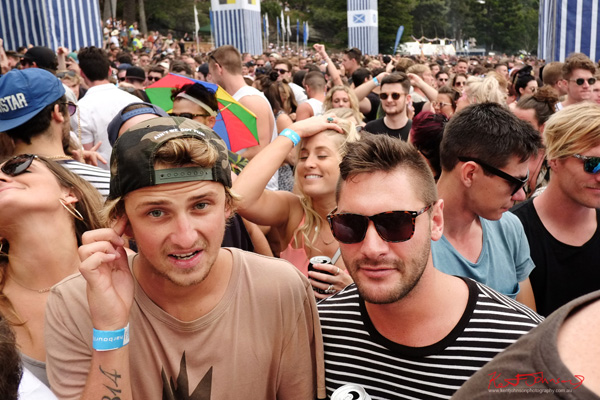 Guys near the stage, view to the back. Harbour Life Music Festival Sydney 2016. Photographed by Kent Johnson for Street Fashion Sydney.
