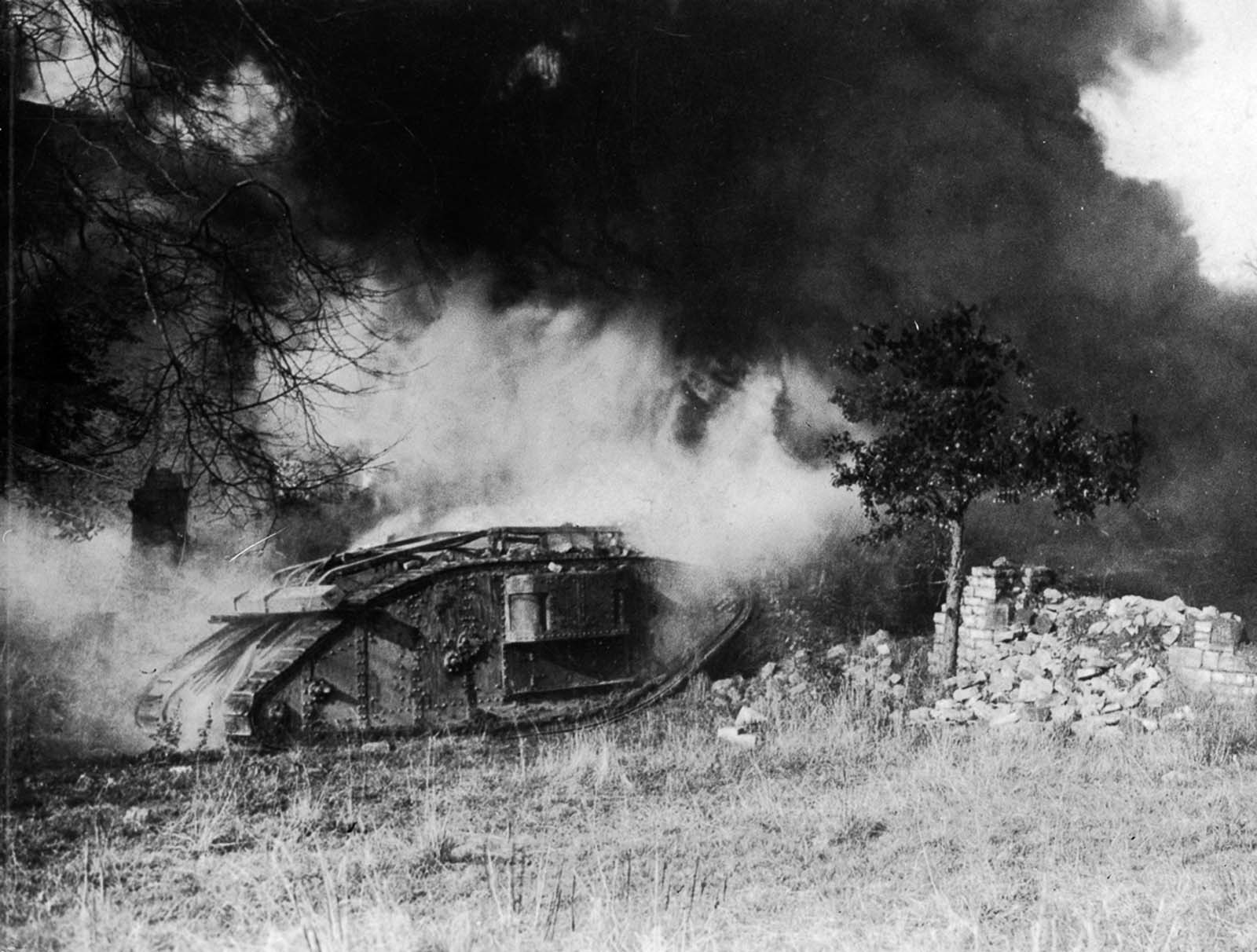 A British tank burns after being hit by a flamethrower. 1918.