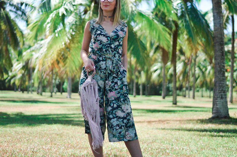 summer outfit retro floral jumpsuit and statement fringe clutch